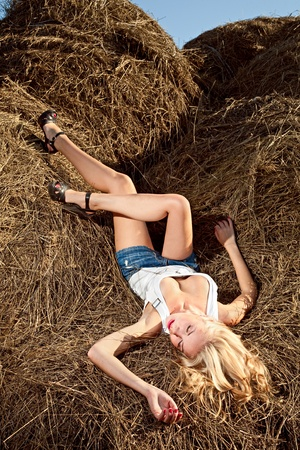 barn girls: beauty woman in hay