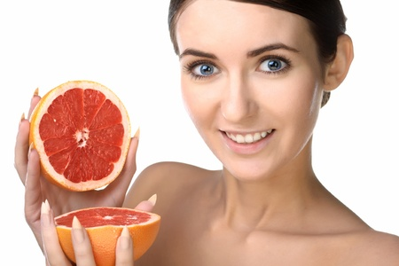 beauty woman with fruits on white background photo