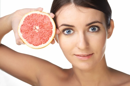 beauty woman with fruit on white background photo