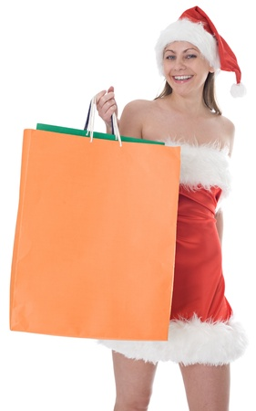 beauty girl in santa hat with color bag over white background photo
