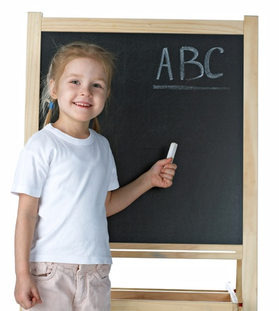 Little girl with blackboard on white background photo
