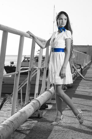 beauty woman on sea with ship photo