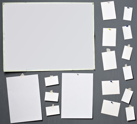 attach: white photo paper attach to gray wall