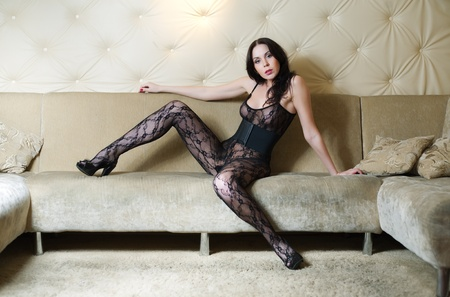 young beauty sexy woman on sofa photo