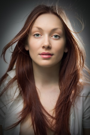 beauty redhaired woman closeup portrait on gray background photo