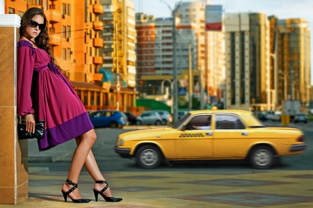 beauty woman in the city at summer time photo