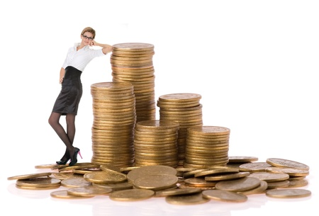 busines woman with column coins over white background Stock Photo - 8850034