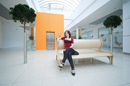 woman in  shopping mall with lift photo