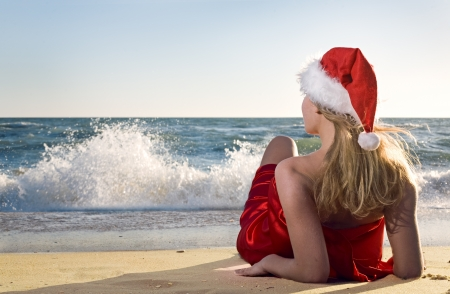 Woman on the beach in santa hat Stock Photo - 8850105