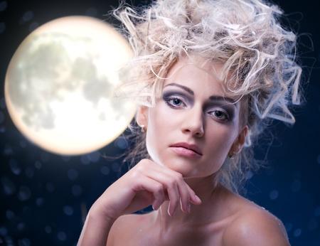 beauty woman  under moon in winter season photo