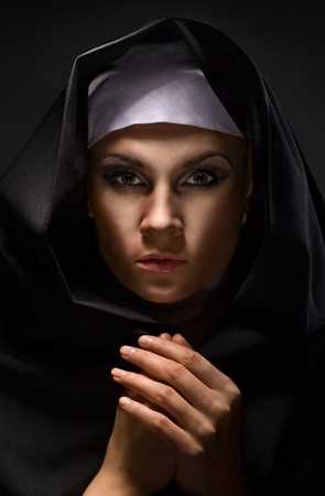 Portrait of a young woman nun in hood Stock Photo - 8850091