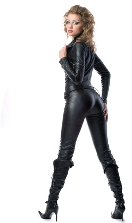 beauty woman in leather overalls over white background photo