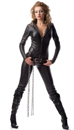 overalls: beauty woman in leather overalls over white background