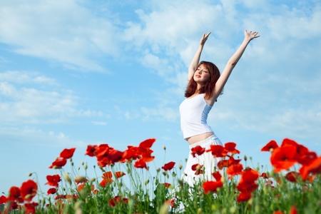 beauty woman in poppy field in white dress Stock Photo - 9759292