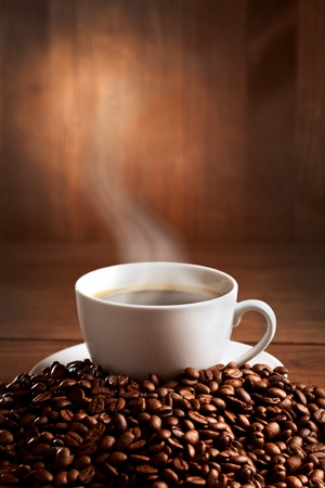 warm cup of ciffee on brown background photo