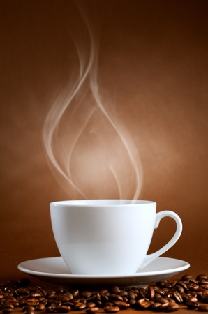 warm drink: warm cup of ciffee on brown background