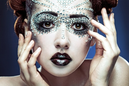 beauty woman makeup with crystals on face on blue background Stock Photo - 9759777