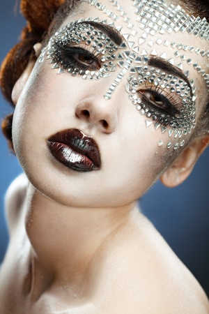 beauty woman makeup with crystals on face on blue background Stock Photo - 9759779