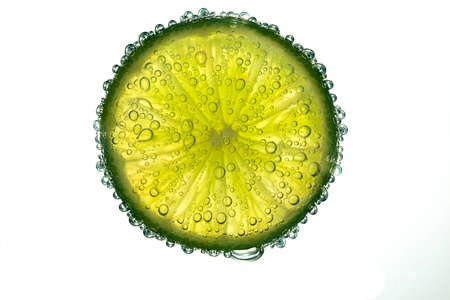 lime in bubbles on white background photo