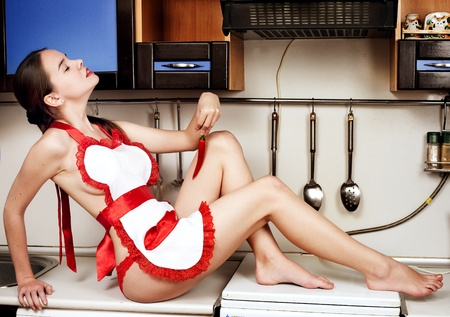 Portrait of sexy housewife  in apron on the kitchen room  Stock Photo