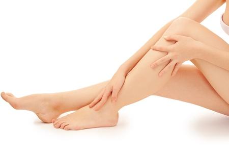 waxed: woman leg over white background Foto de archivo