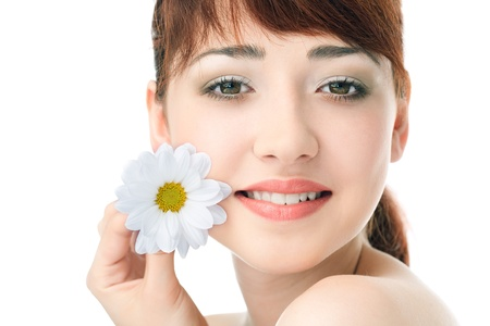 Beauty woman with flower over white background photo