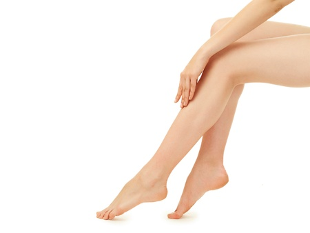 waxed: woman legs over white background