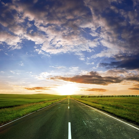 field stripped: asphalt road  at summer time Stock Photo