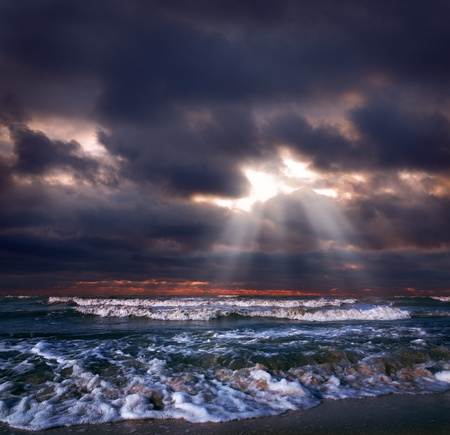 storm clouds: Ocean storm with sun beam Stock Photo