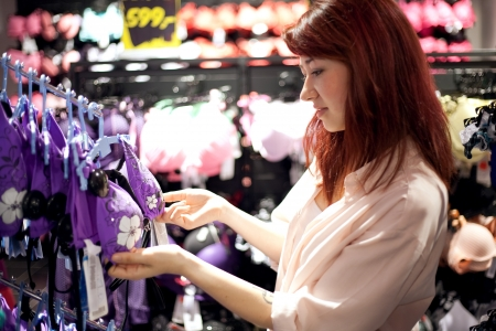 young woman shopping in supermarket Stock Photo - 21350949