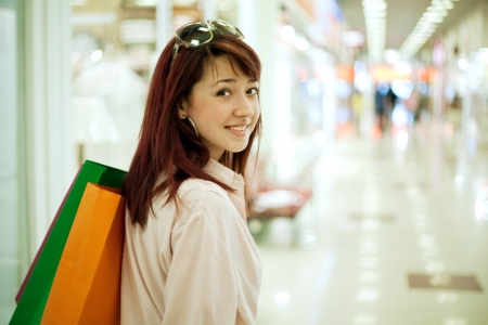 Beautiful shopping woman in mall Stock Photo - 21350952