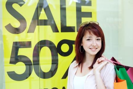 Beautiful shopping woman in mall  Stock Photo - 21350953