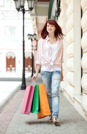 Beautiful shopping woman in mall Stock Photo - 21350975