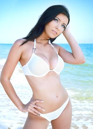 beach breast: beauty woman in bikini at sea beach