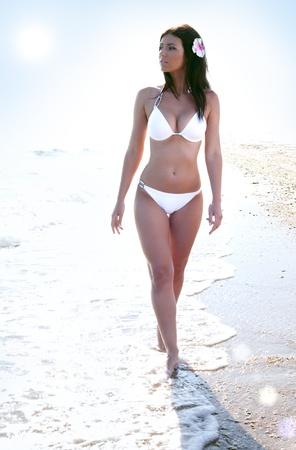 sun tan: beauty woman in bikini at sea beach