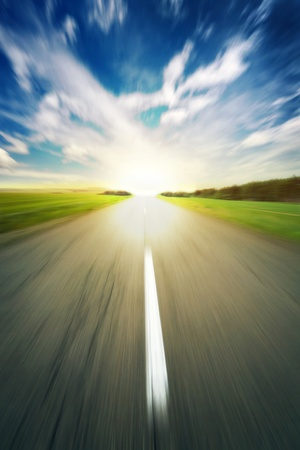 field stripped: asphalt road under blue sky speed blur background