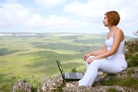 computer centers: beauty woman with laptop on nature