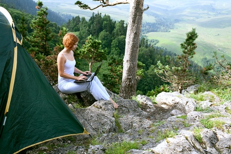 beauty woman with laptop on nature photo