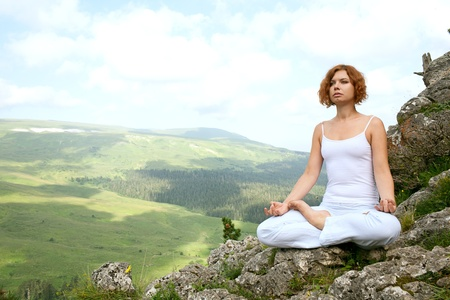 woman training yoga on beauty landscape photo