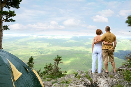 woman mountain: young couple on nature with tent Stock Photo