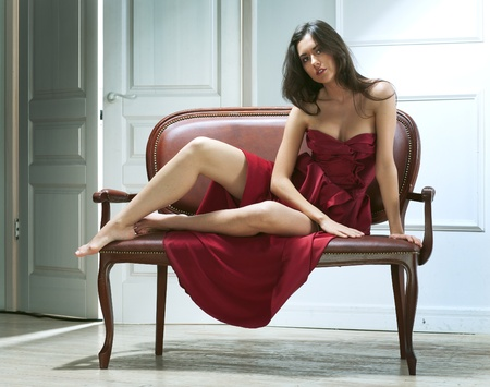 beauty young woman on sofa in home Stock Photo - 12077106