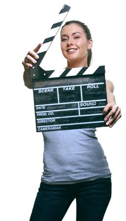 Attraente giovane donna con scheda del film batacchio