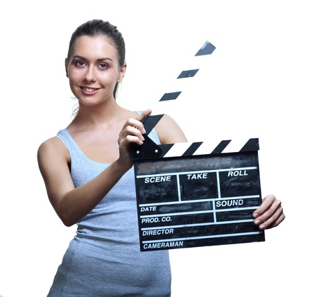 young add: Attractive young woman with movie clapper board