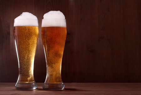 beer in glass on wooden background photo