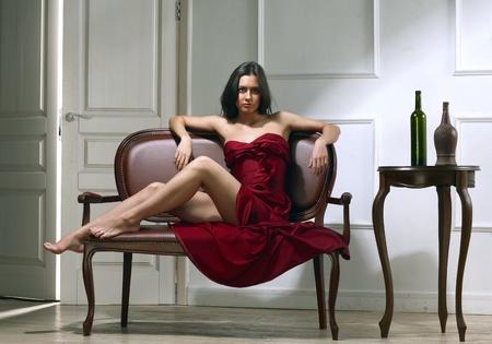 feet on desk: beauty brunette woman on sofa Stock Photo