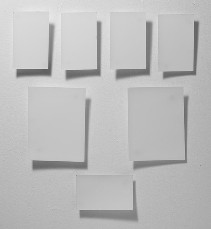 close up  white note paper on gray background photo