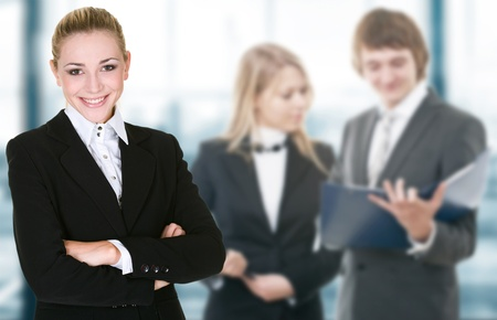 office environment: Business woman in an office environment with team