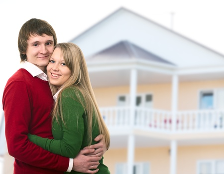 happy young couple and their new home photo