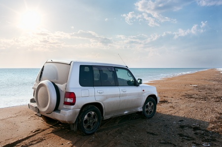 off-road vehicle on the  sandy beach photo