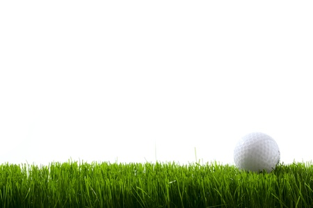 off course: Golf ball on green grass over white